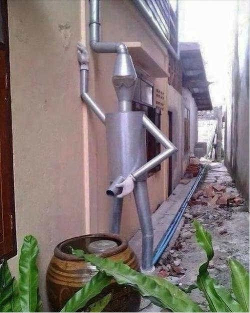 Funny Picture Thread [12]-tin-man-watering-system.jpg
